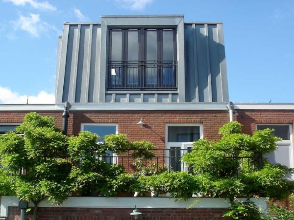 Zinken opbouw met Frans balkon en openslaande deuren plaatsen? Vergelijk de prijzen!